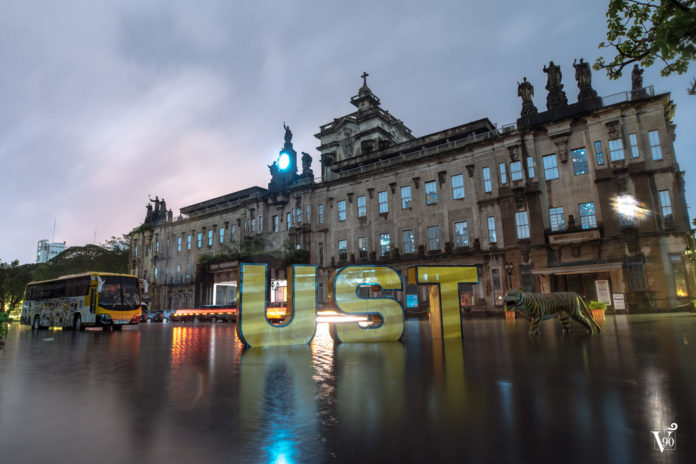 The UST Main Building on the evening of Aug. 11 as heavy rains brought by Tropical Storm Karding continue to bring flood in Metro Manila and surrounding cities. (Photo by Michael Angelo M. Reyes/The Varsitarian)